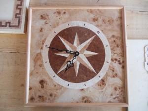 Orologio mosaico rosa dei venti